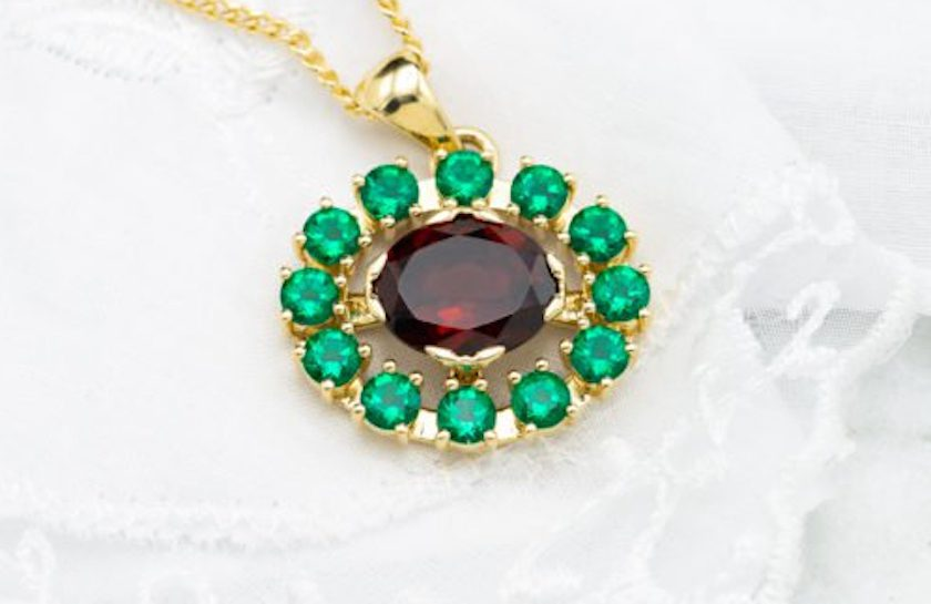 garnet and lab-created emerald pendant - garnet symbolism and legends