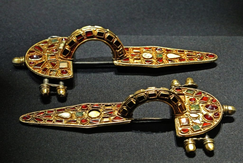 Roman brooch with garnet inlay - garnet symbolism and legends