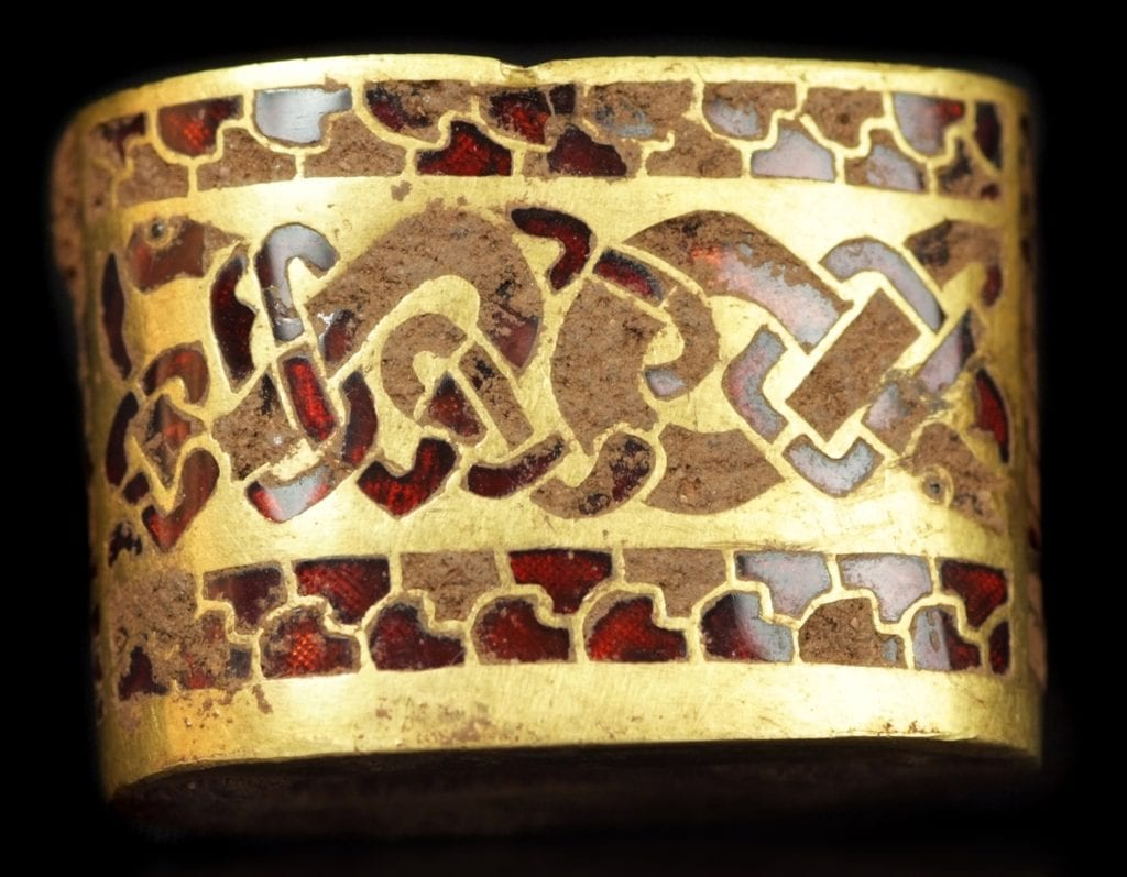 Saxon hilt with garnet inlay - garnet symbolism and legends