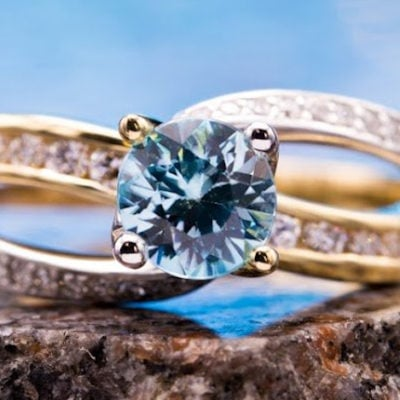 blue zircon with channel-set diamonds - engagement ring setting