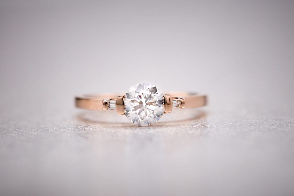 round diamond with baguette side stones - vintage engagement ring