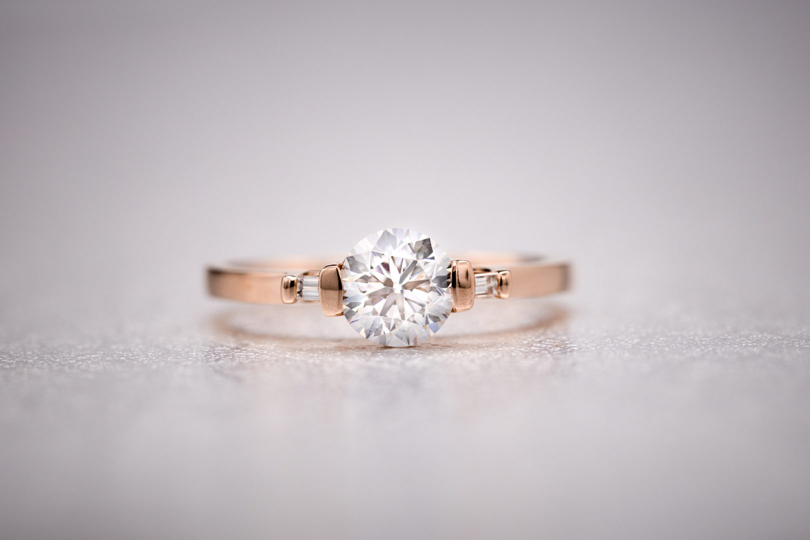 round diamond with baguette side stones - vintage engagement rings