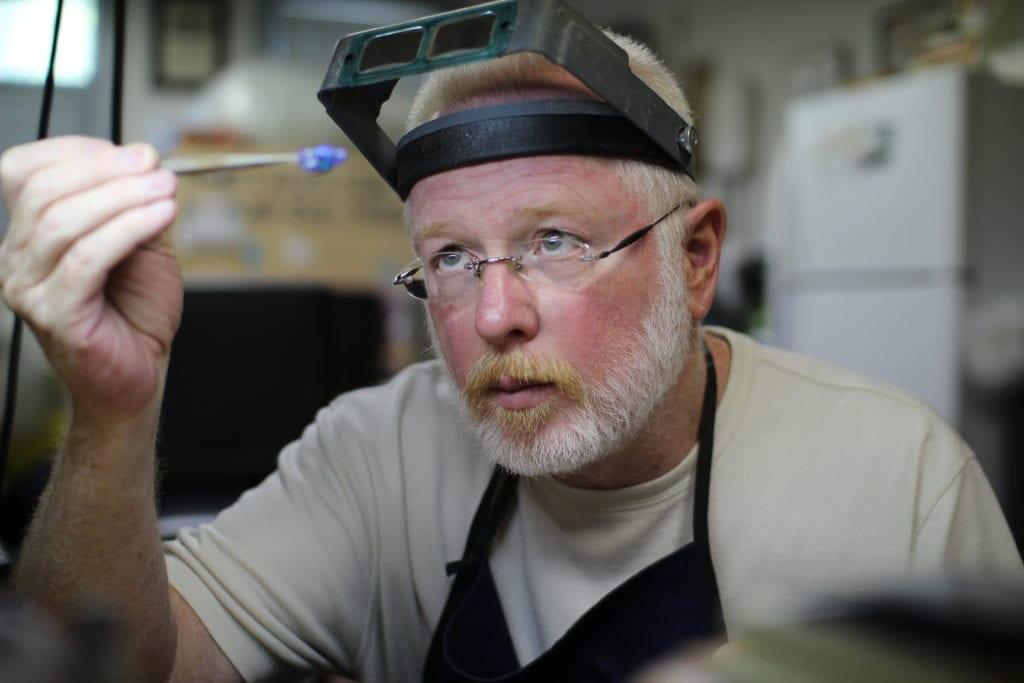 joel ragan examining opal - opal expert