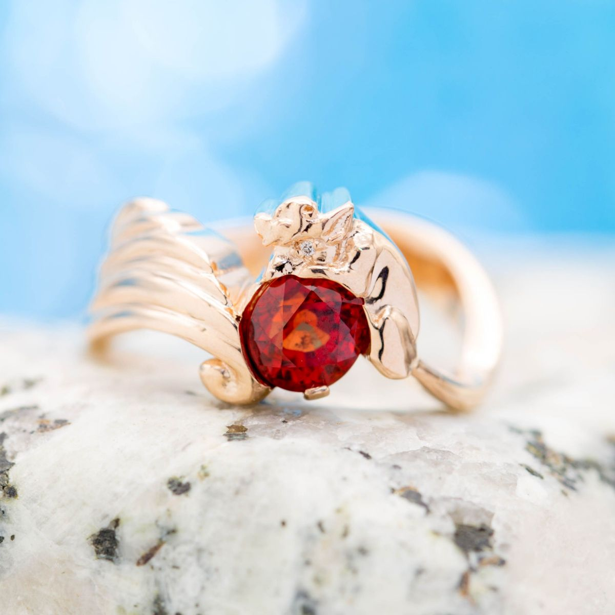 orange-red ruby engagement ring