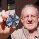 sapphire expert jeffrey bergan with a trapiche sapphire