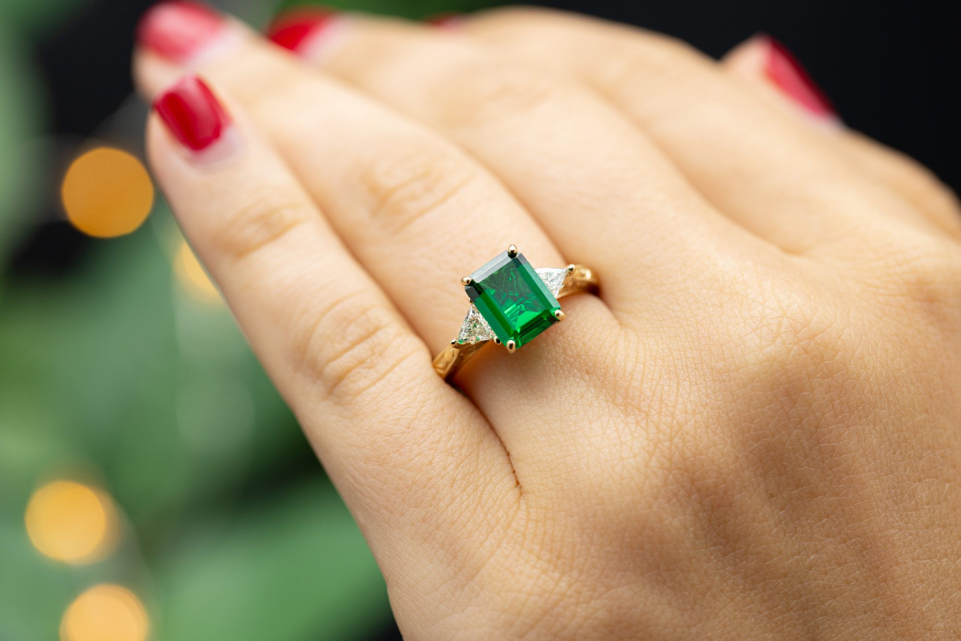 three-stone emerald engagement ring