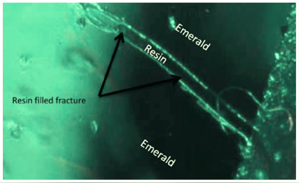 surface reaching fissure in resin-filled emerald