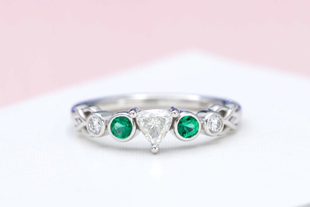 trillion-cut diamond and emerald engagement ring