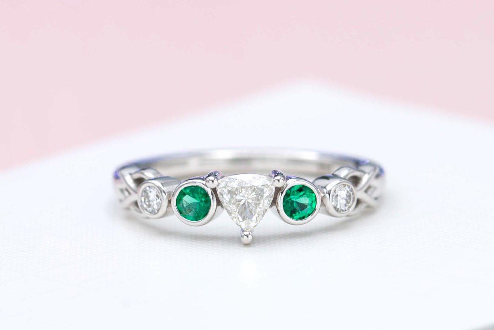 trillion-cut diamond and emerald engagement ring