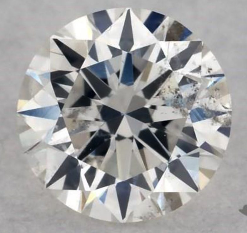 0.30-ct, I1 round with grayish inclusions