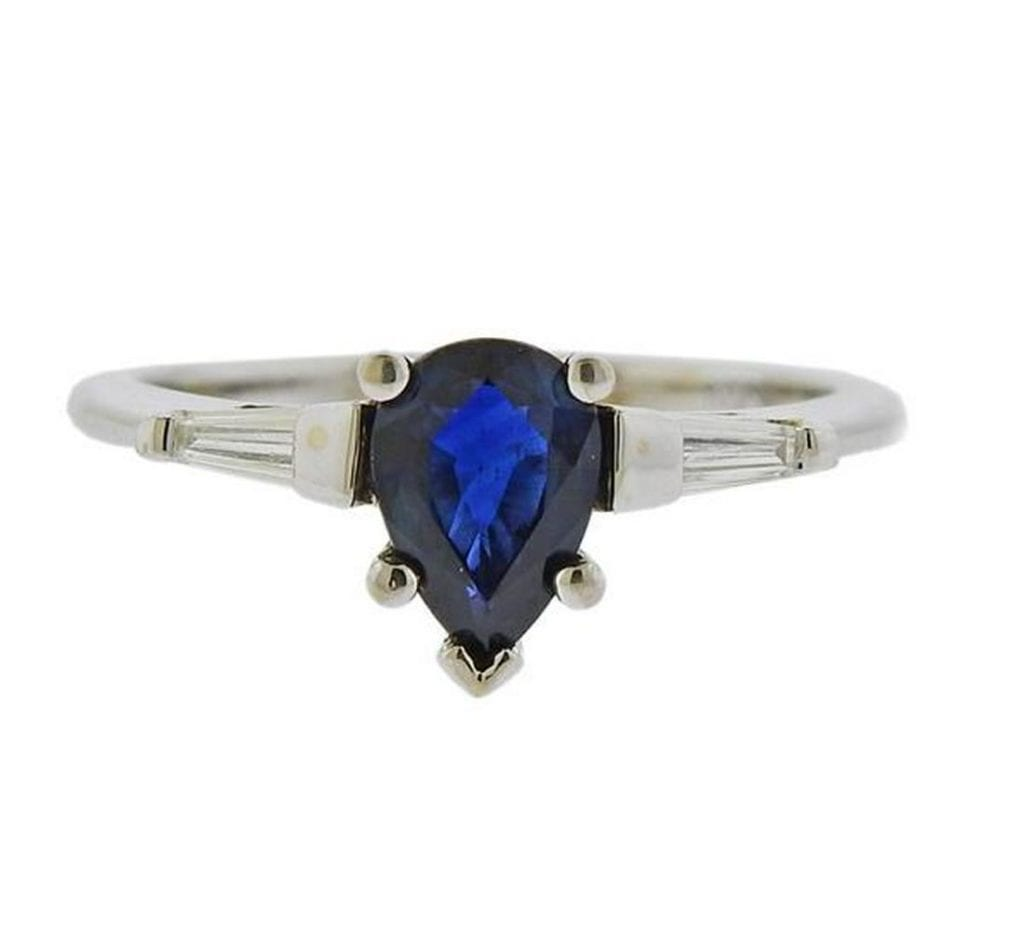 white gold engagement ring with sapphire center stone