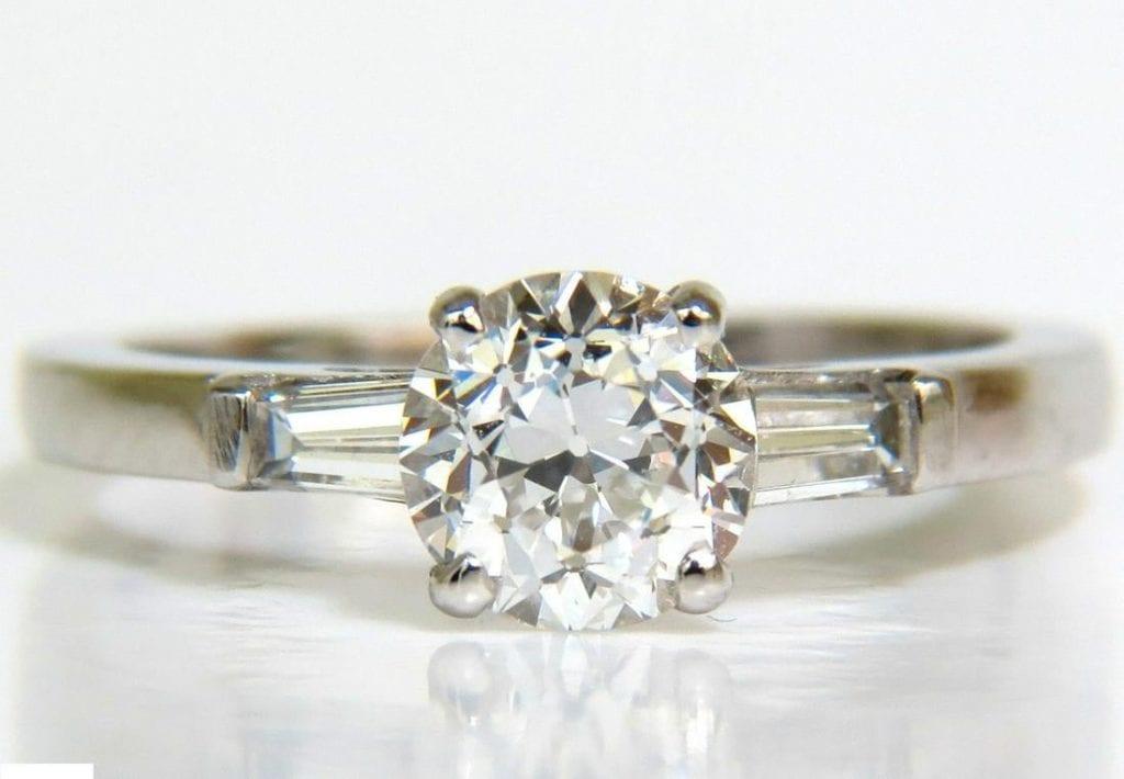 F color OEC diamond in white gold ring
