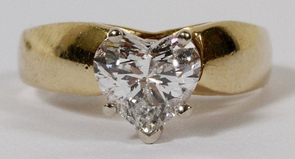 yellow gold ring with white prongs - heart-cut diamond