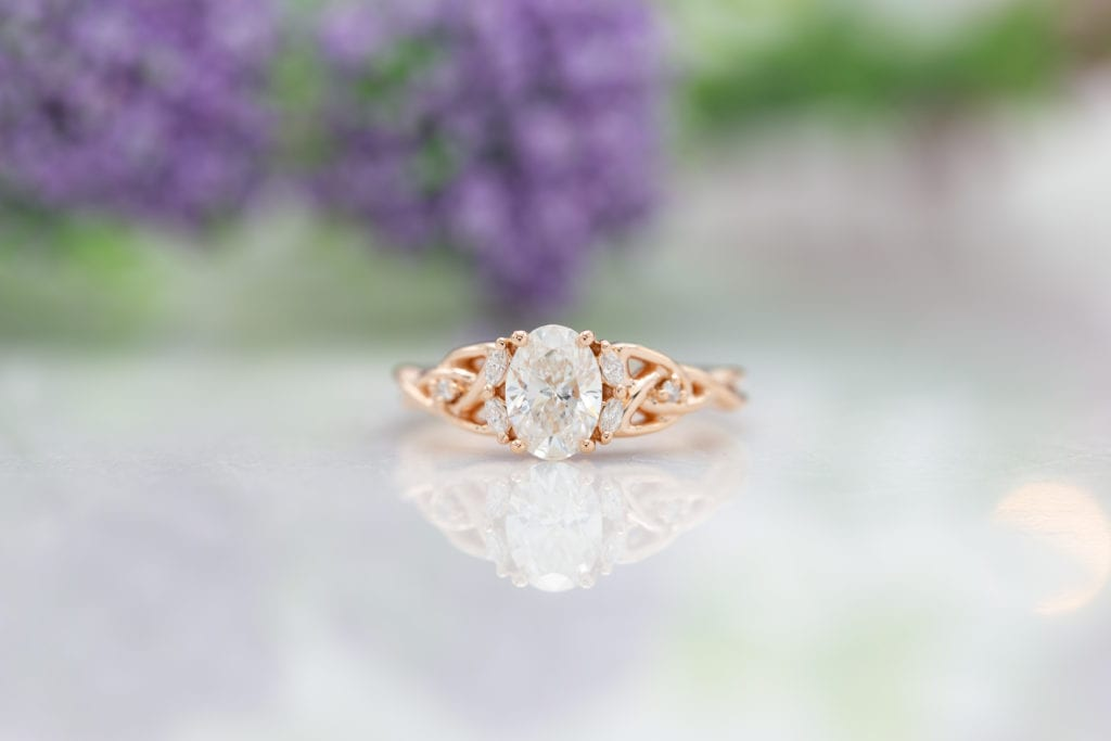 lab-created, oval-cut diamond in rose gold ring