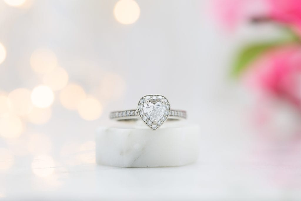 D color heart-cut diamond halo and pave ring