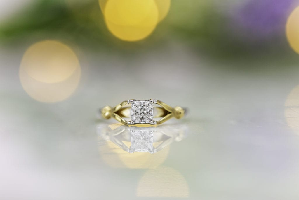 split shank engagement ring with radiant-cut diamond