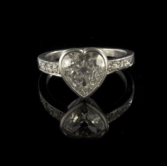 bezel-set heart-cut diamond engagement ring