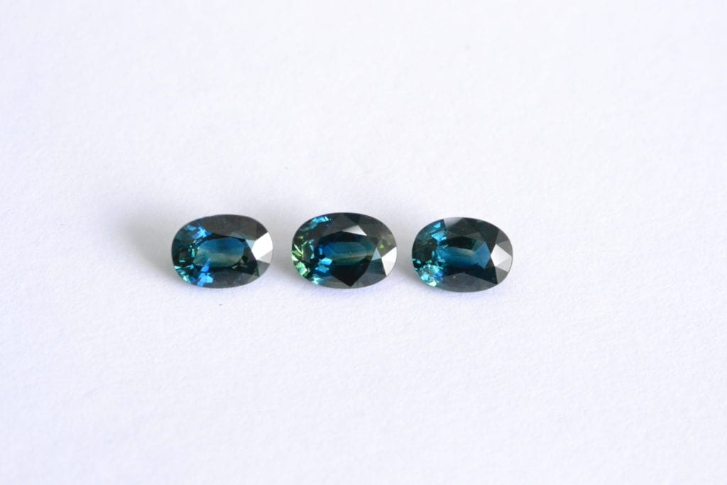 three teal sapphires