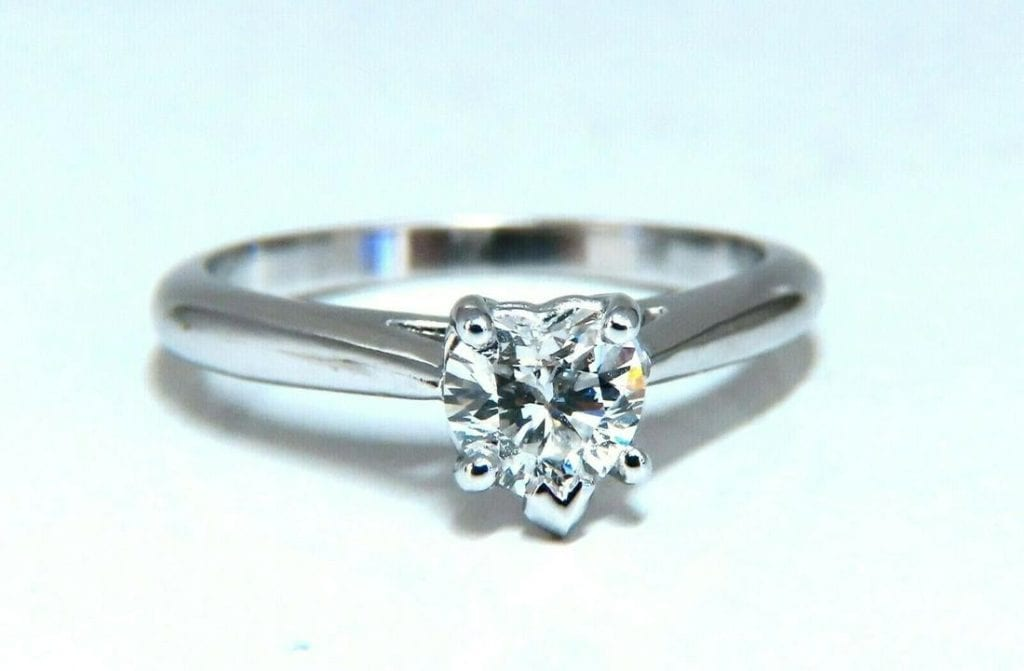 platinum engagement ring with heart-cut diamond