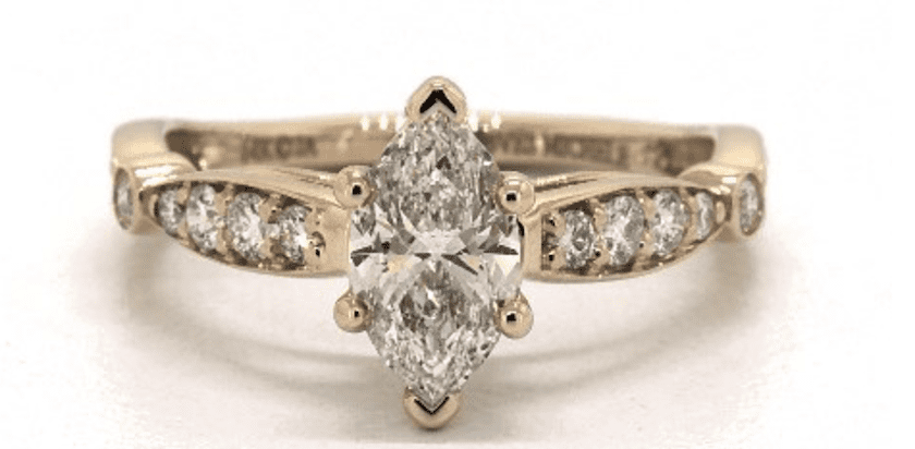 K color diamond in a vintage-style setting