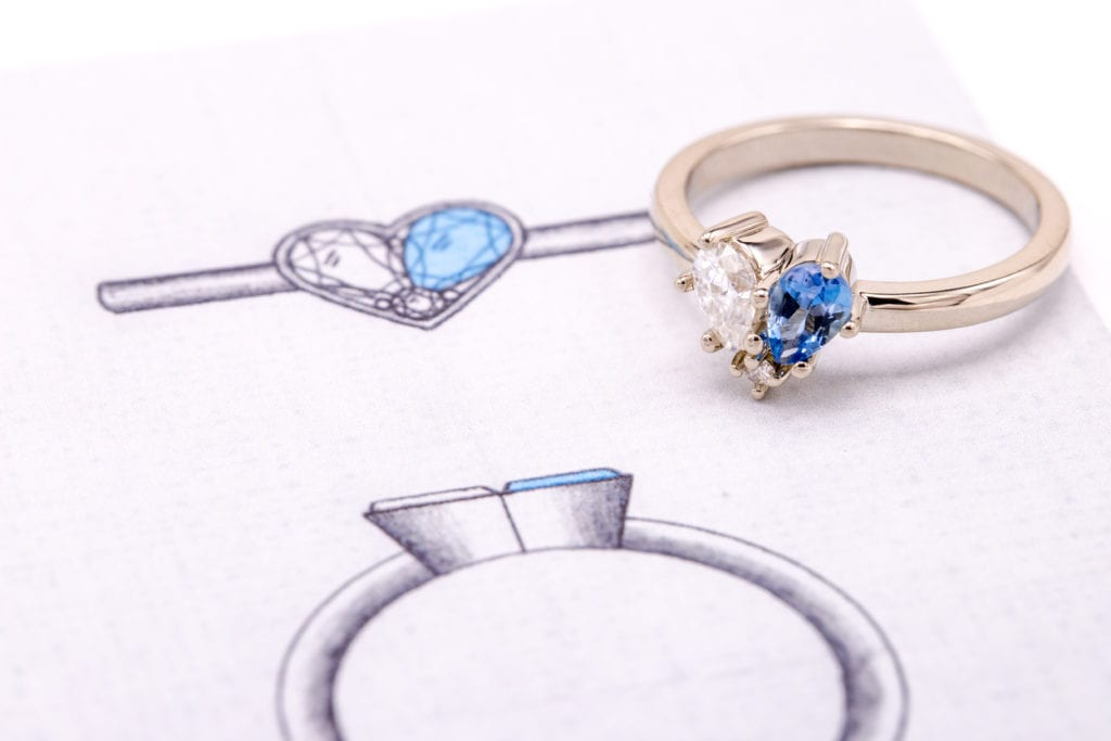 pear-cut aquamarine and moissanite in white gold