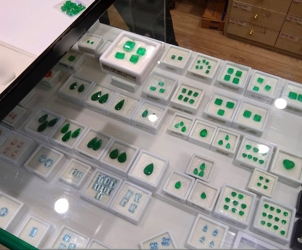 emeralds and aquamarines on display