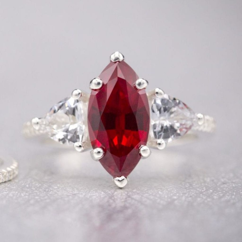 lab-created marquise ruby with trillion cut white sapphiren thin, elegant pave band Custom Made